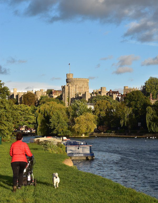 Lady with pram and dog follow the Thames Path by Windsor Castle