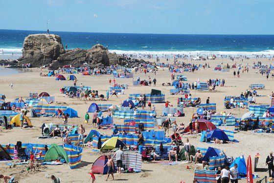 A busy beach scene, Cornwall, on the South-West Coast Path.