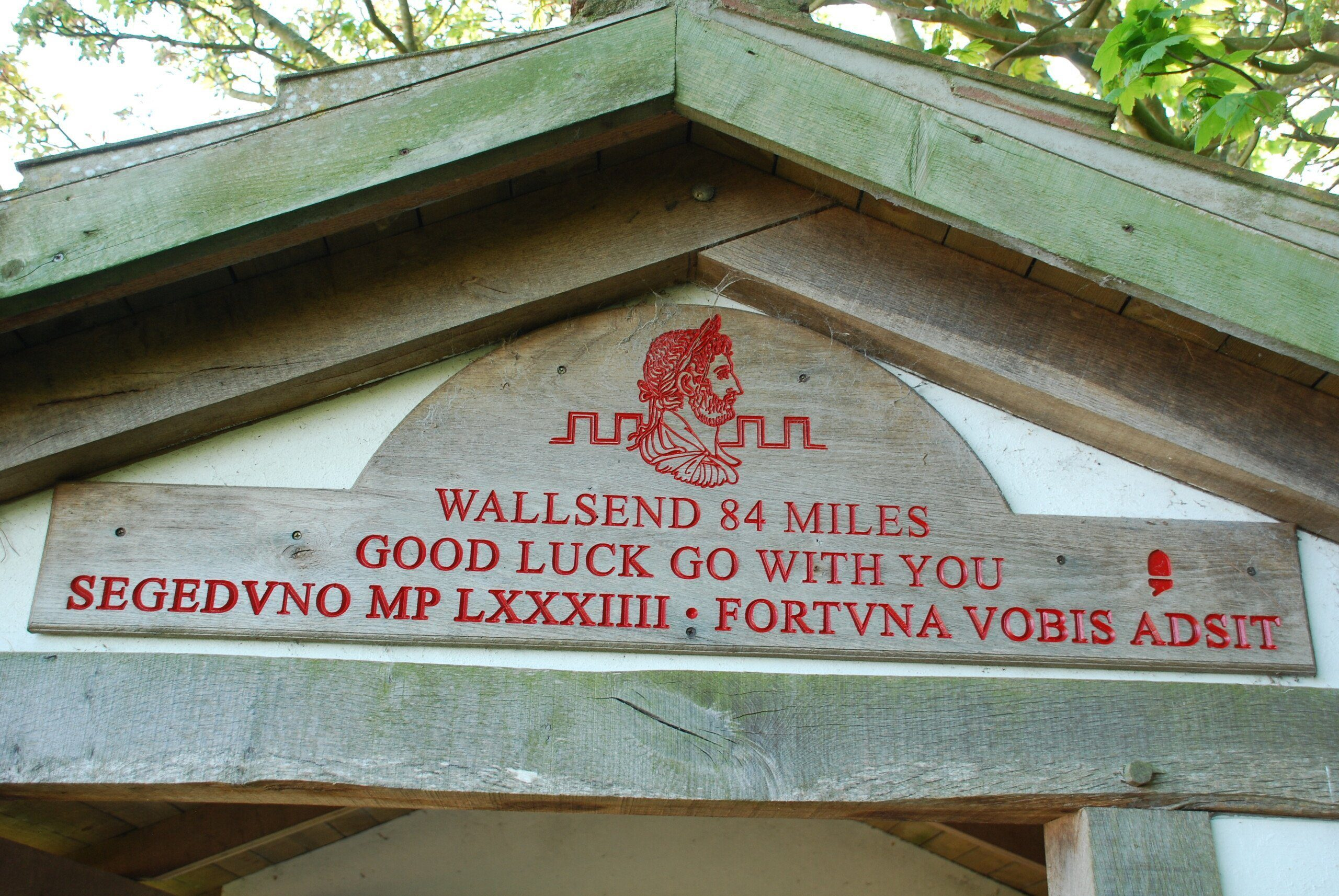 Close-up of sign at Bowness-on-Solway, written in Latin and English, wishing trekkers 'Good luck' at the start of their 84 mile trek across England along the Hadrian's Wall Path.