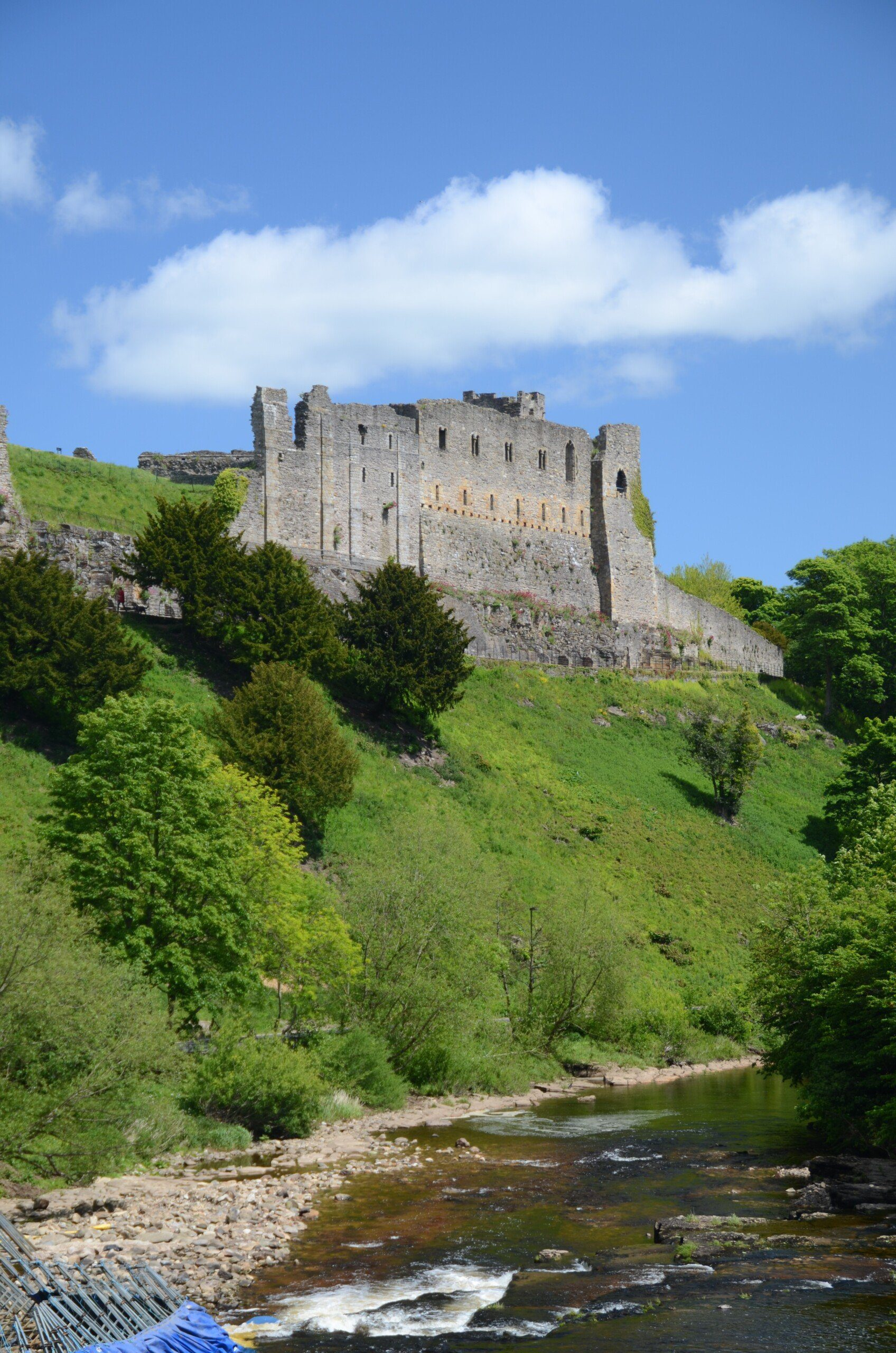 The ruins of Richmond Castle, rising above the River Swale