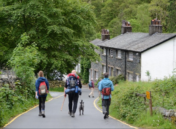 Coast to Coast Path: Three trekkers strolling into Seatoller