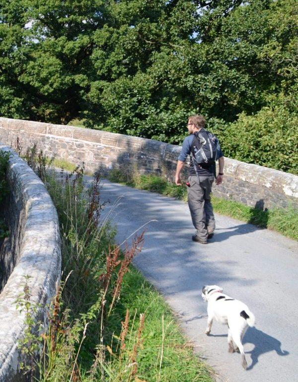 Dales Way, Daisy and Joel cross a bridge