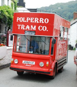 Red tourist bus at Polperro