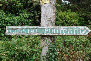 Coast Path Cornwall weather-beaten signpost