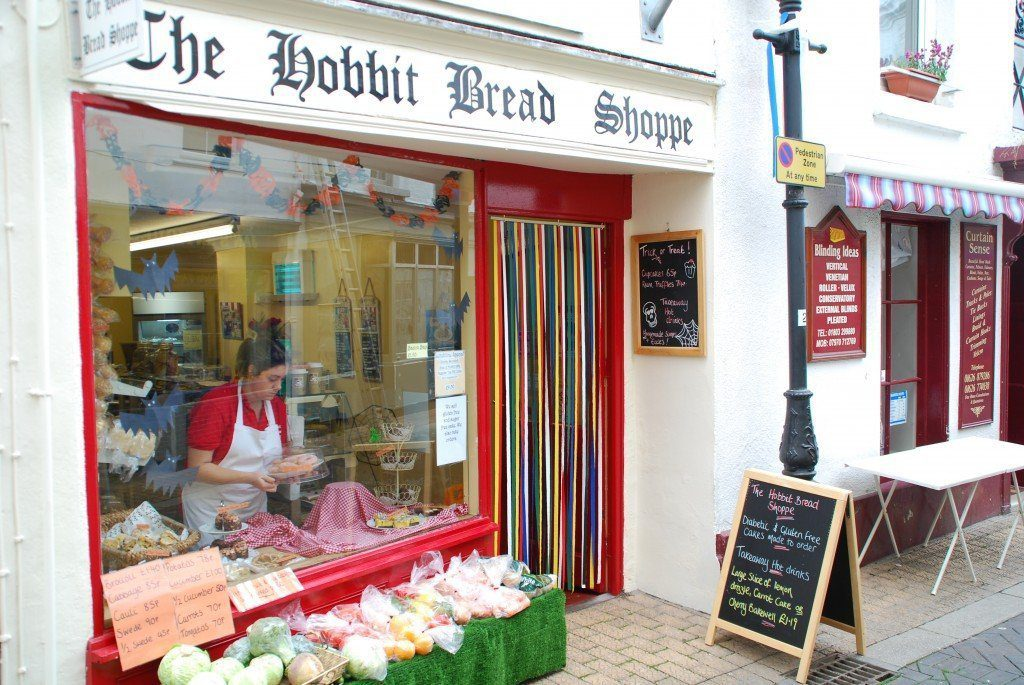 Lady dressing window of Hobbit Bread Shoppe, Teignmouth