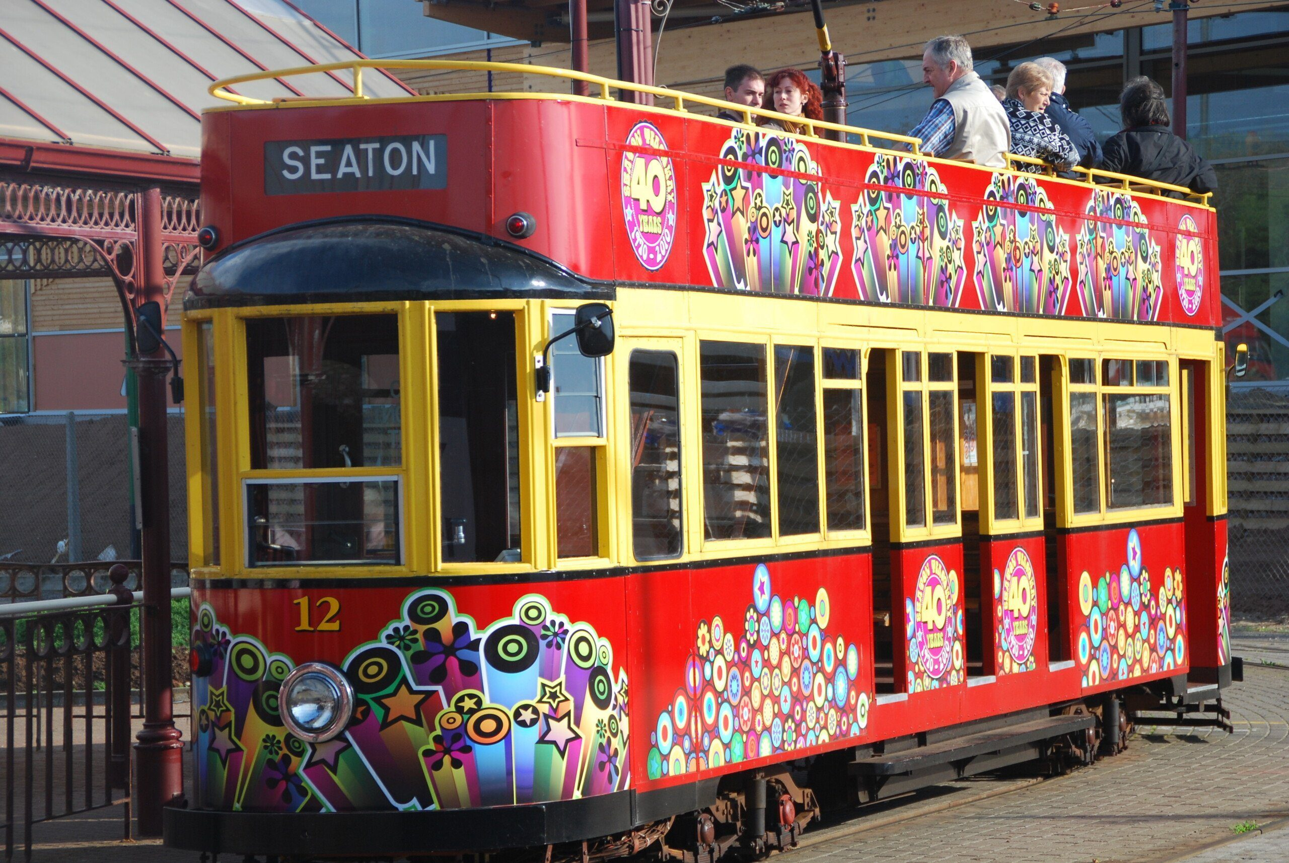 Red colourfully painted Seaton Tram
