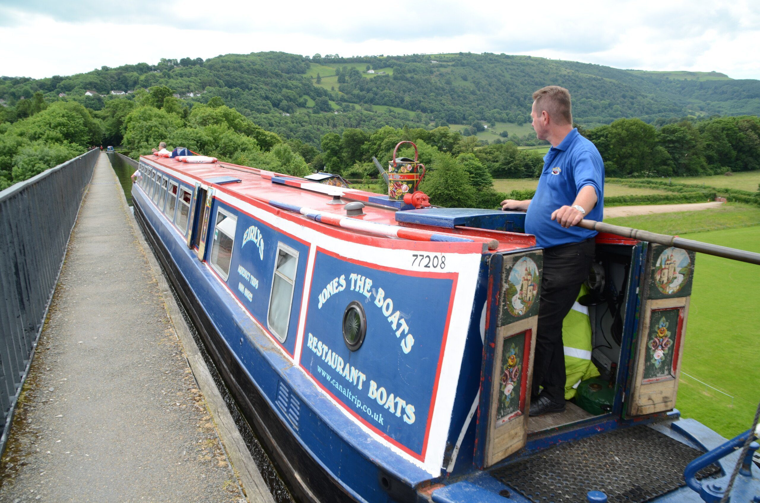 Canal boat going across Pontcysyllte Aqueduct, an aqueduct it shares with the Offa's Dyke Path