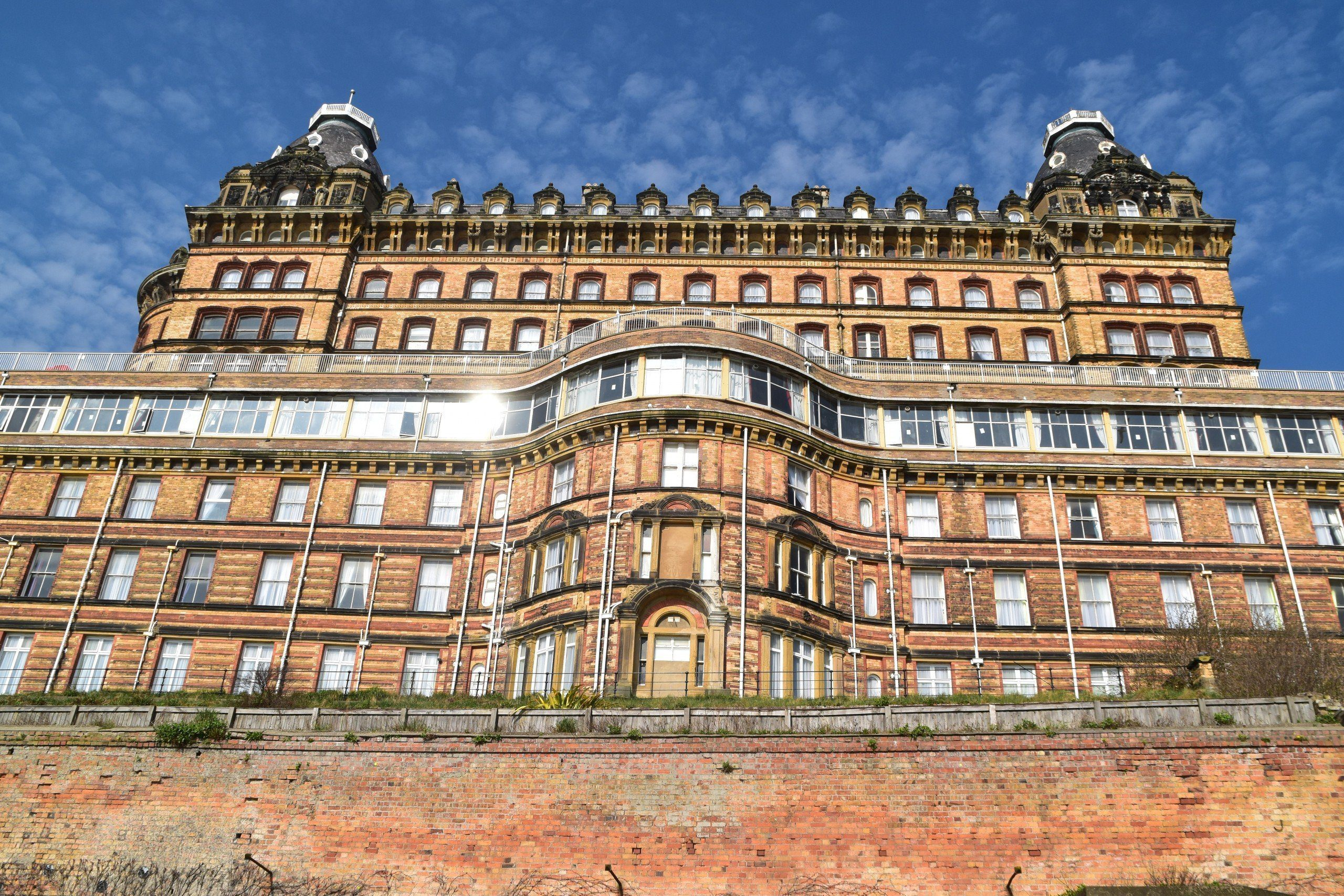 Facade of the Scarborough Grand Hotel with windows glinting in the sun