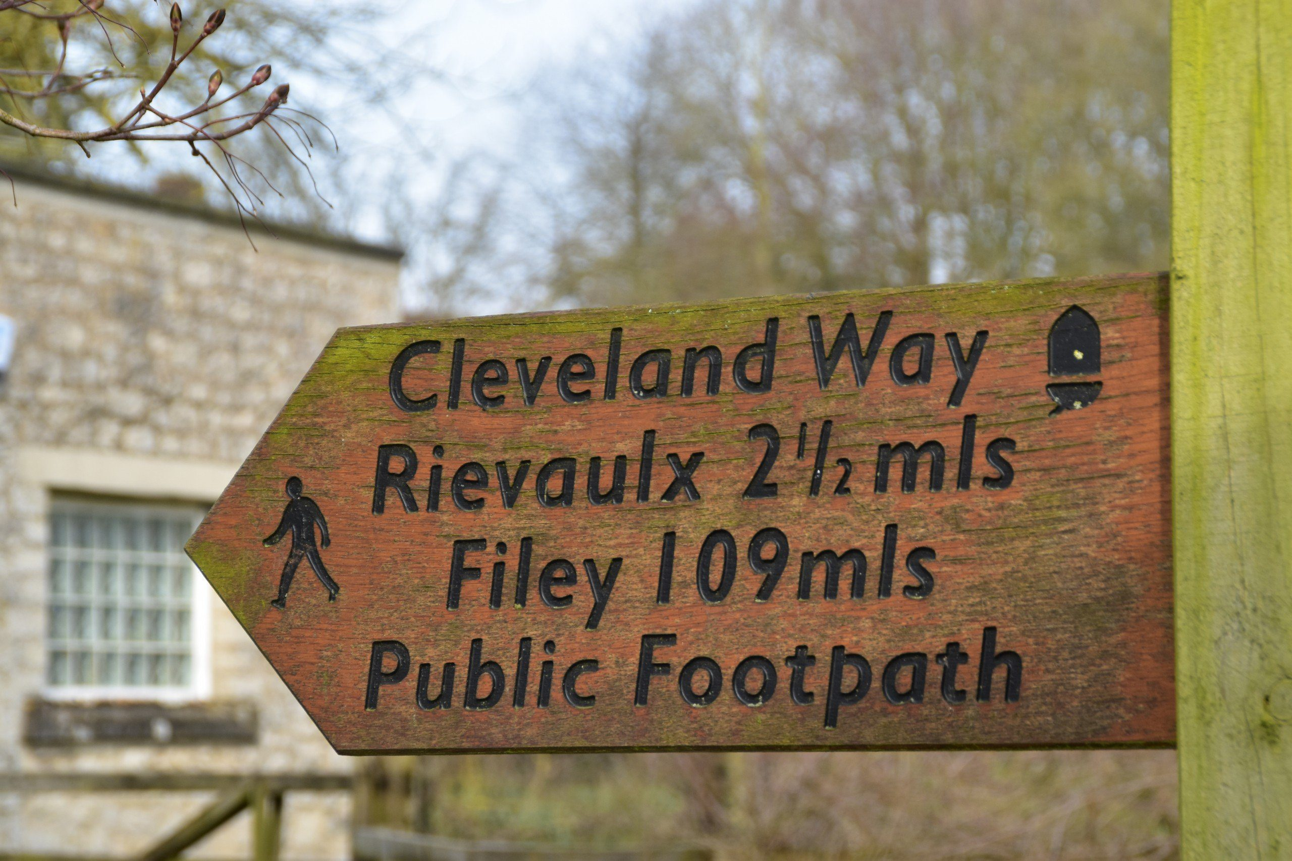 Cleveland Way wooden signpost pointing to Rievaulx and Filey