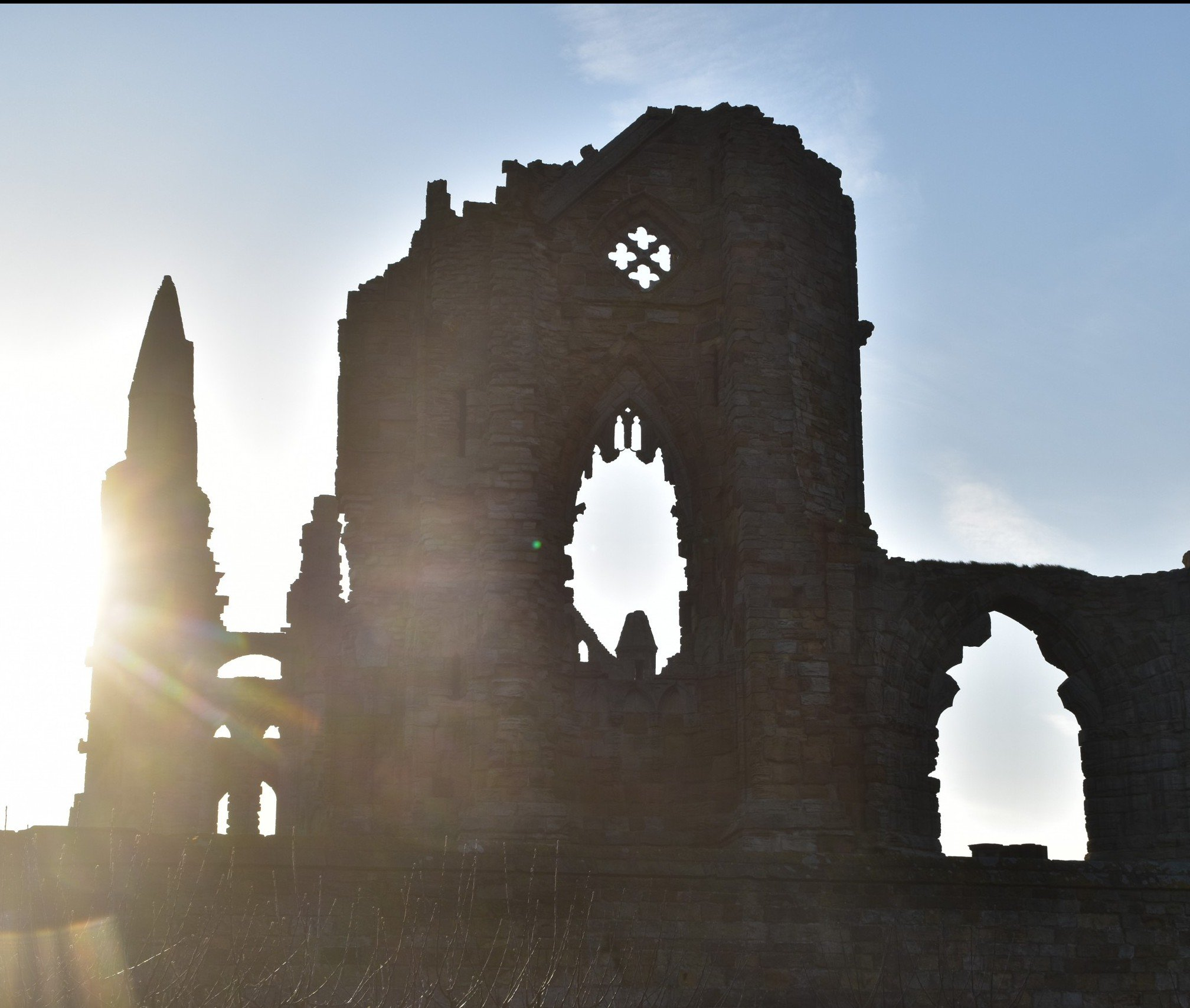 The ruins of Whitby Abbey with the morning sun rising behind, Cleveland Way