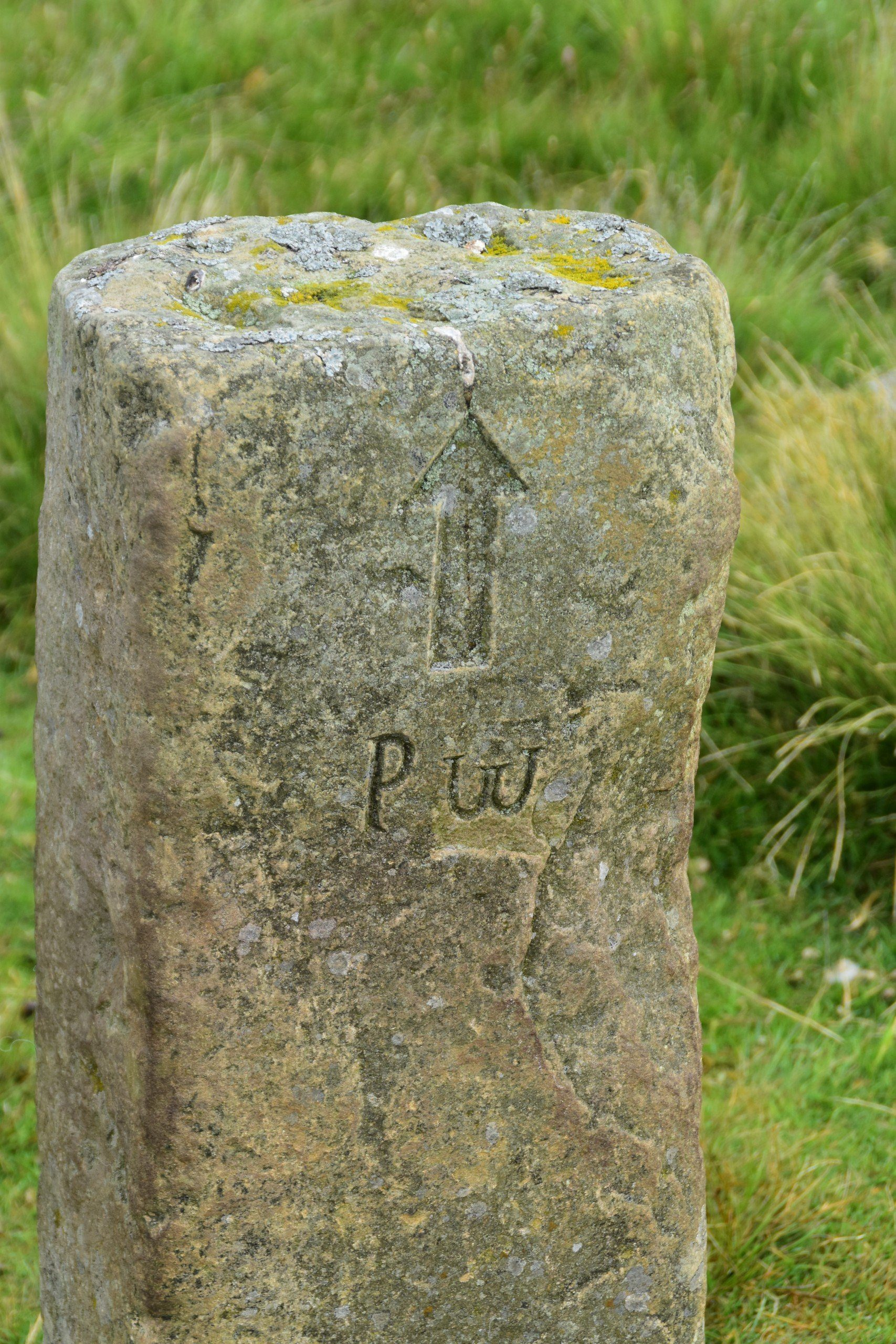 'PW' carved into stone - a rudimentary signpost