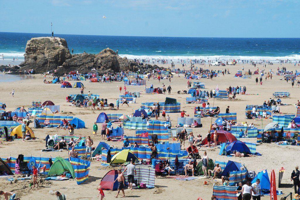 South-West Coast Path, a busy beach scene, Cornwall.