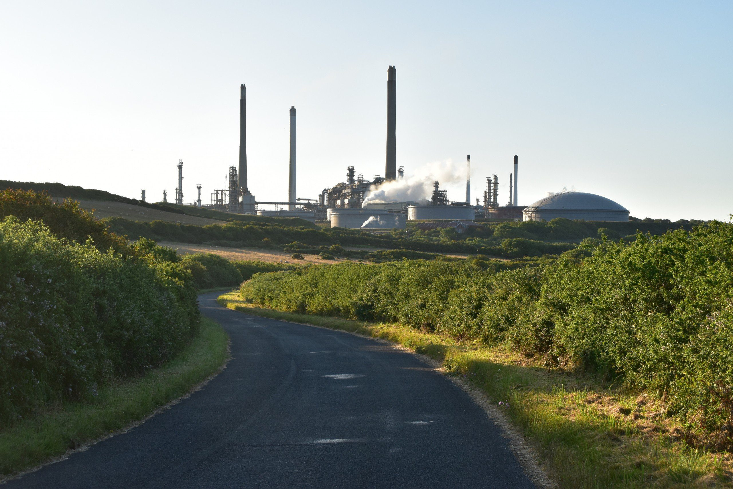Road leading to chimneys of the oil works at Milford Haven
