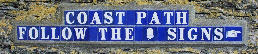 Coast Path blue-tiled sign