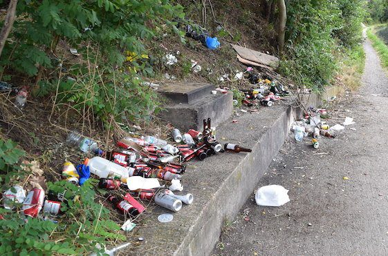 A lot of litter strewn along the towapath of the Grand Union Canal