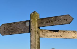 Old wooden Pennine Way sign pointing to Old Ing, Horton in Ribblesdale and High Birkwith